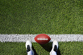 high angle view shot of a american football player standing on the field with copy space