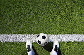 shot of a soccer player standing on the field with copy space