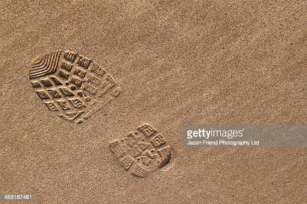 Boot / Foot print on the sandy beach