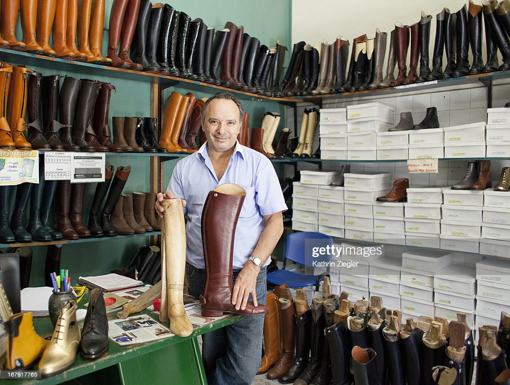 boot maker in his shop