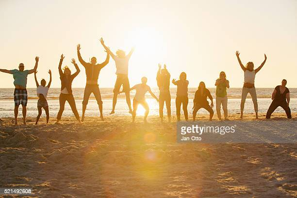 Bootcamp people performing sports at the beach of St.Peter-Ording,Germany