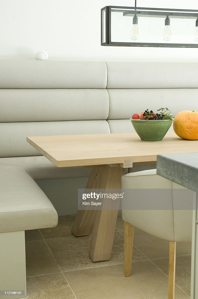 Booth and table in modern dining room : Stock Photo