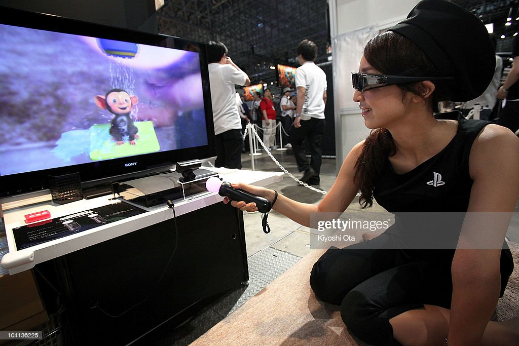 A booth assistant demonstrates 'Me & My Pet' using Sony Computer Entertainment Inc.'s PlayStation Move motion controller on the 3D-supported PlayStation 3 (PS3) video game console during the Tokyo Game Show 2010 at Makuhari Messe on September 16, 2010 in Chiba, Japan. The computer and video game convention, which will be held until September 19, features exhibitions of upcoming game software and hardware from 194 companies and organizations to draw business visitors and the general public.