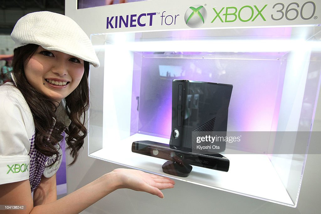 A booth assistant displays Microsoft Corp.'s Kinect hands-free motion-controlled device with the Xbox 360 video game console during the Tokyo Game Show 2010 at Makuhari Messe on September 16, 2010 in Chiba, Japan. The computer and video game convention, which will be held until September 19, features exhibitions of upcoming game software and hardware from 194 companies and organizations to draw business visitors and the general public.