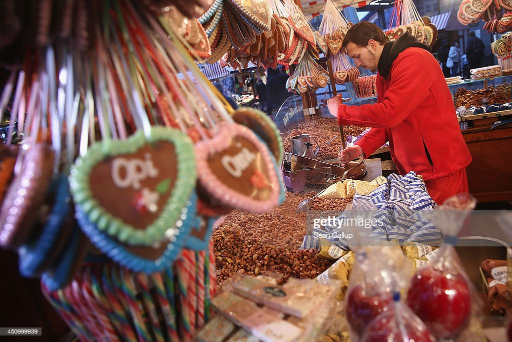 A booth worker mixes roasted almonds at a shop selling sweets at a Christmas market on Potsdamer Platz on November 20, 2013 in Berlin, Germany. Berlin, with still over a month to go, is preparing for Christmas.