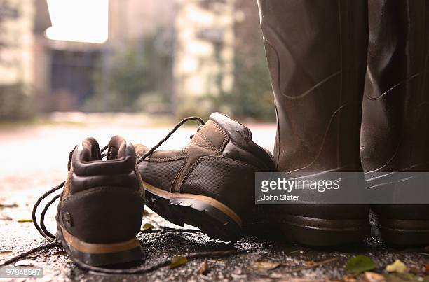 boots and shoes on doorstep