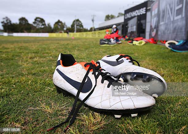 Boots are left behind as runners get used for sprinting laps by players during a StKilda Saints AFL training session at Linen House Oval on November...
