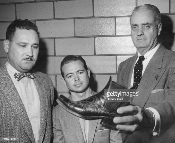 Boots Brought His Downfall Detective Ben Balay holds one of the size 6 cowboy boots that led to the arrest of Bobbie V Warren on charges of...
