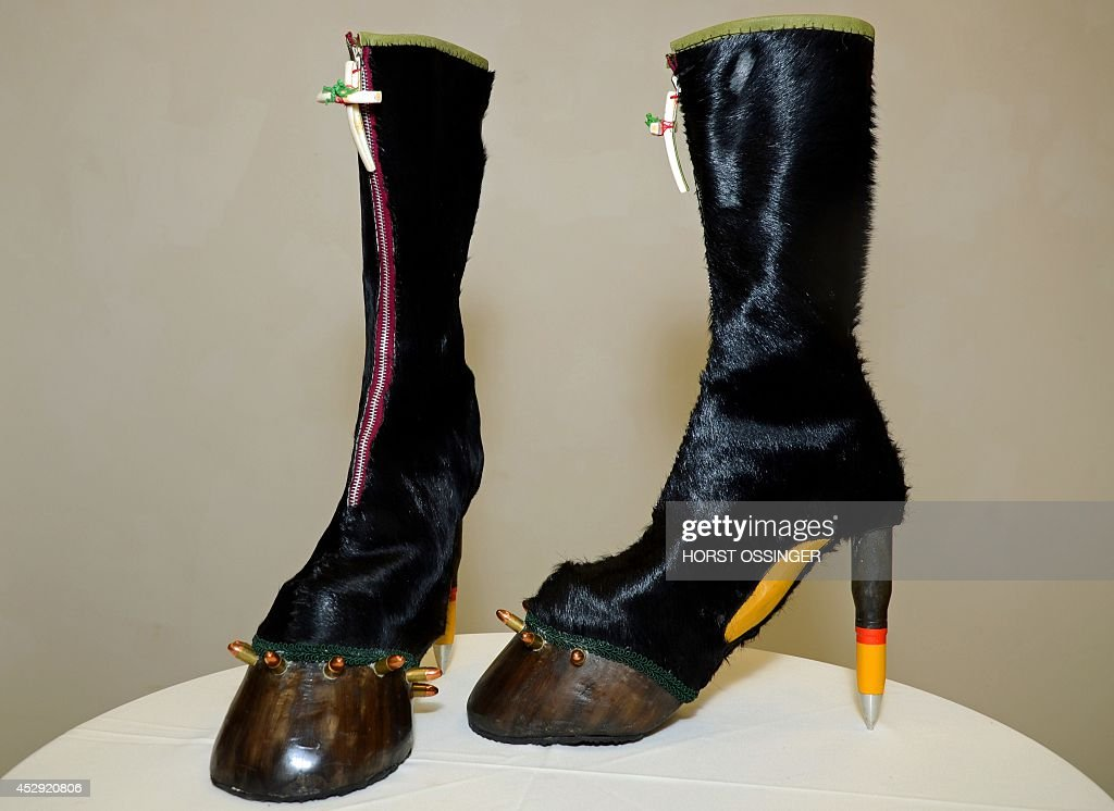 S NAME Boots called «Bones & Weapons» by German artist Iris Schieferstein are pictured on July 29, 2014 in Duesseldorf, western Germany ahead of the exhibition «Art Shoes - Shoes in Contemporary Art». The exhibition ART SHOES that will be presented in Duesseldorf from July to September 27, 2014 shows art works symbolizing the Torture of Fashion.