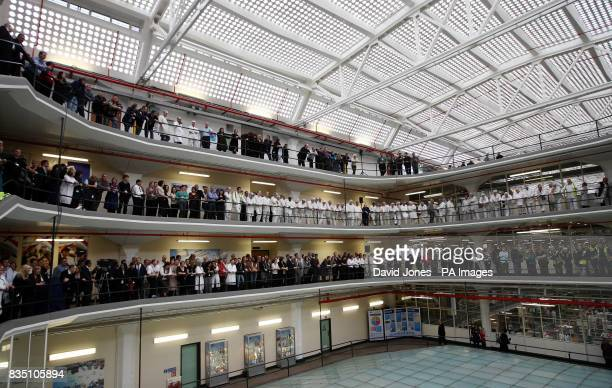 Boots employees line the balconies of their Art Deco grade 1 listed building to watch Britain's Prince Charles as he visits the headquarters of the...