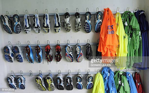 Boots hang on the wall of the locker room of the Olympique de Marseille football team new training center named after RobertLouis Dreyfus is seen...