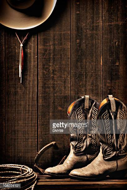 Boots, Lariat and Cowboy Hat Hanging on Wall