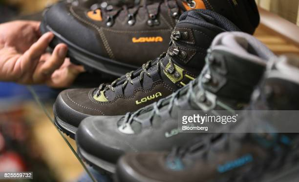 Boots LLC brand shoes sit on display during the Outdoor Retailer Summer Market Show in Salt Lake City Utah US on Saturday July 29 2017 Bloomberg is...