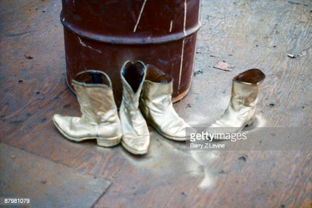 Boots used by ShaNaNa after having been recently painted gold while onstage at the Woodstock Music and Arts Fair in Bethel New York August 15 17 1969