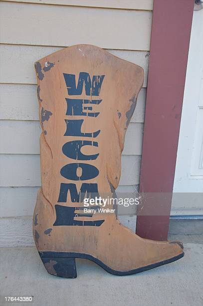 Boot-sign welcoming guests at front door.