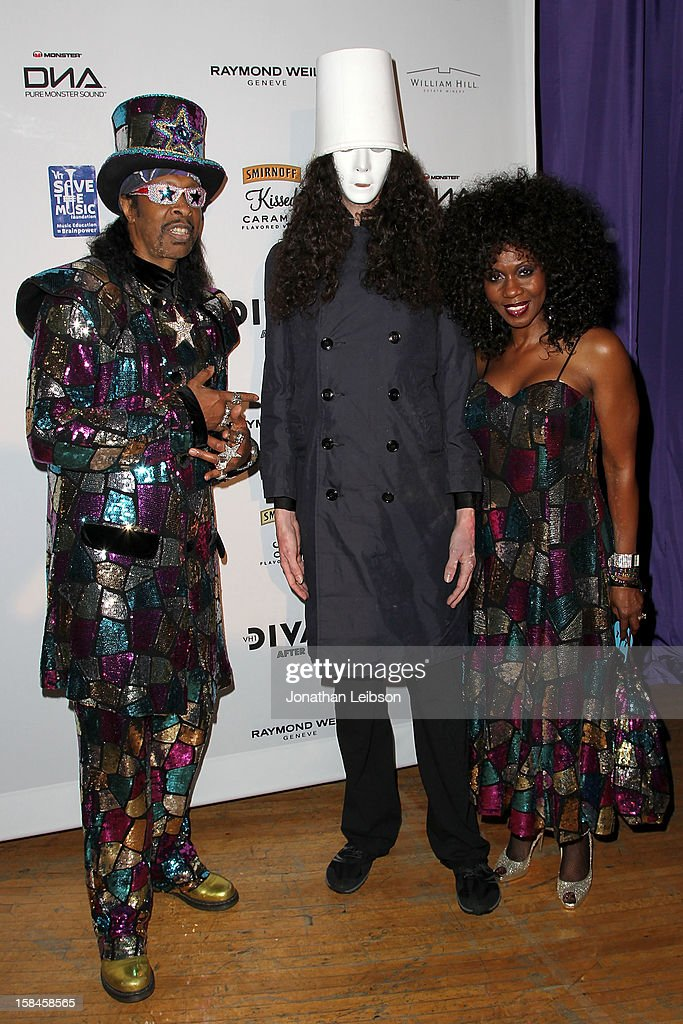 <a gi-track='captionPersonalityLinkClicked' href=/galleries/search?phrase=Bootsy+Collins&family=editorial&specificpeople=221725 ng-click='$event.stopPropagation()'>Bootsy Collins</a>, <a gi-track='captionPersonalityLinkClicked' href=/galleries/search?phrase=Buckethead&family=editorial&specificpeople=3090769 ng-click='$event.stopPropagation()'>Buckethead</a> and Patti Collins attend the VH1 Divas After Party To Benefit The VH1 Save The Music Foundation at The Shrine Auditorium on December 16, 2012 in Los Angeles, California.