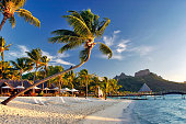 Bora Bora is one of the most beautiful places on earth: pristine, unspoilt nature accompanied by luxurious resorts to have the best possible experience. Bent palm trees, serene ocean waters and Mount