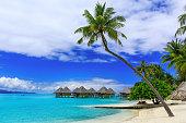 Over-water bungalows of luxury tropical resort, Bora Bora island, near Tahiti, French Polynesia, Pacific ocean