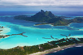 Some luxury resorts with their overwater bungalows are clearly visible