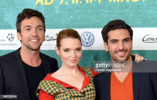 Bora Dagtekin Karoline Herfurth and Elyas M'Baraek attends the premiere of the film 'Fack Ju Goehte' on October 29 2013 in Munich Germany