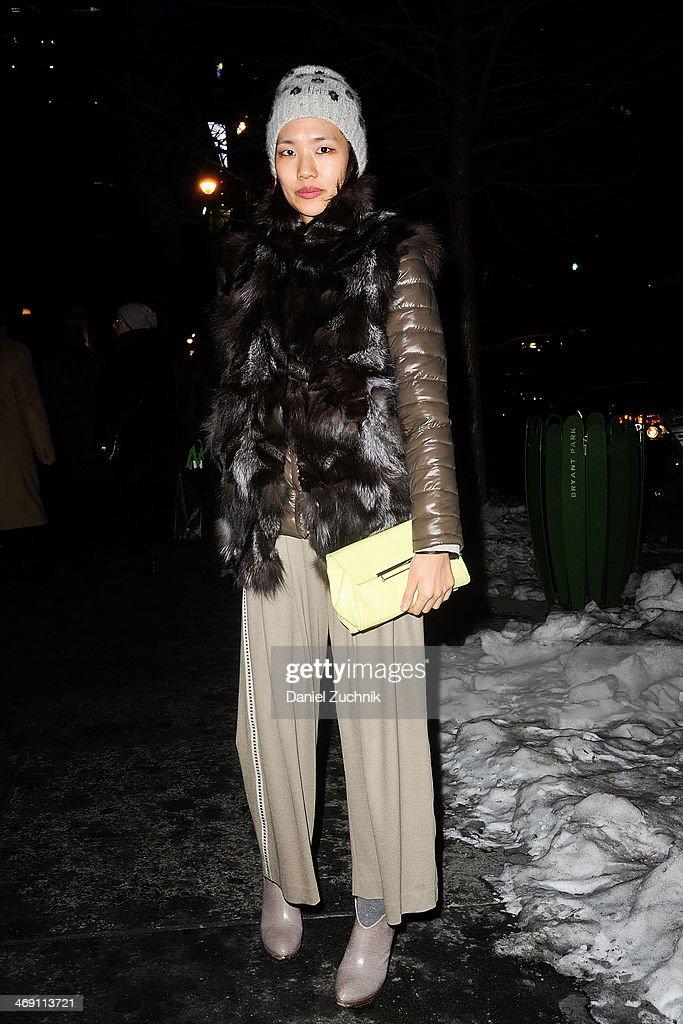 Bora Ryu is seen outside the Marchesa show wearing a Yigal Azrouel coat, Danielle Nicole handbag and Alexandre Birman shoes on February 12, 2014 in New York City.