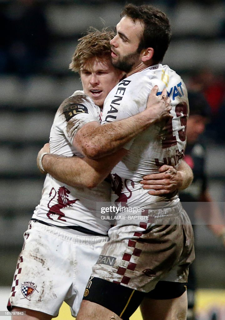 Bordeaux Begles' French center Julien Rey (R) is congrqtulated by Bordeaux Begles' French winger Blair Connor after scoring a try during the French Top 14 rugby union match between Stade Francais and Bordeaux-Begles on February 16, 2013 at the Stade Charlety in Paris. AFP PHOTO / GUILLAUME BAPTISTE