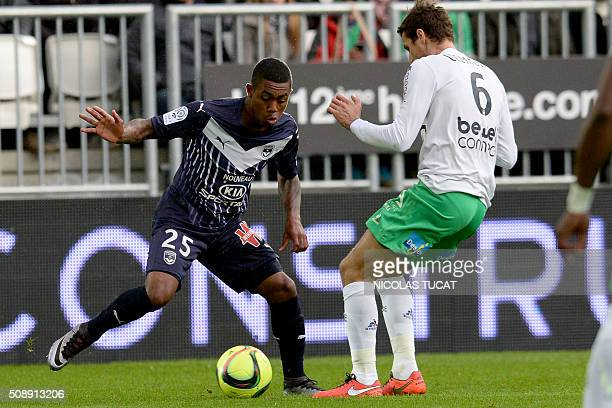 Bordeaux' Brazilian forward Malcom vies for the ball with SaintEtienne's French midfielder Jeremy Clement during the French L1 football match between...