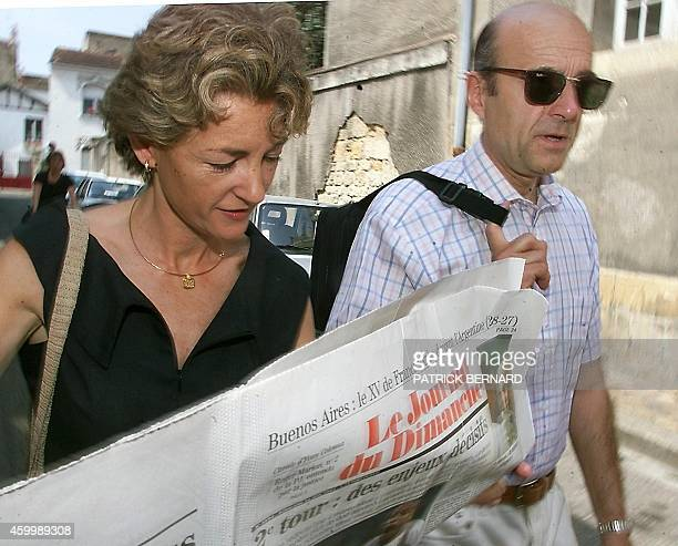 Bordeaux deputymayor and former prime minister Alain Juppe of the Union for the Presidential majority and wife Isabelle arrive at a polling station...