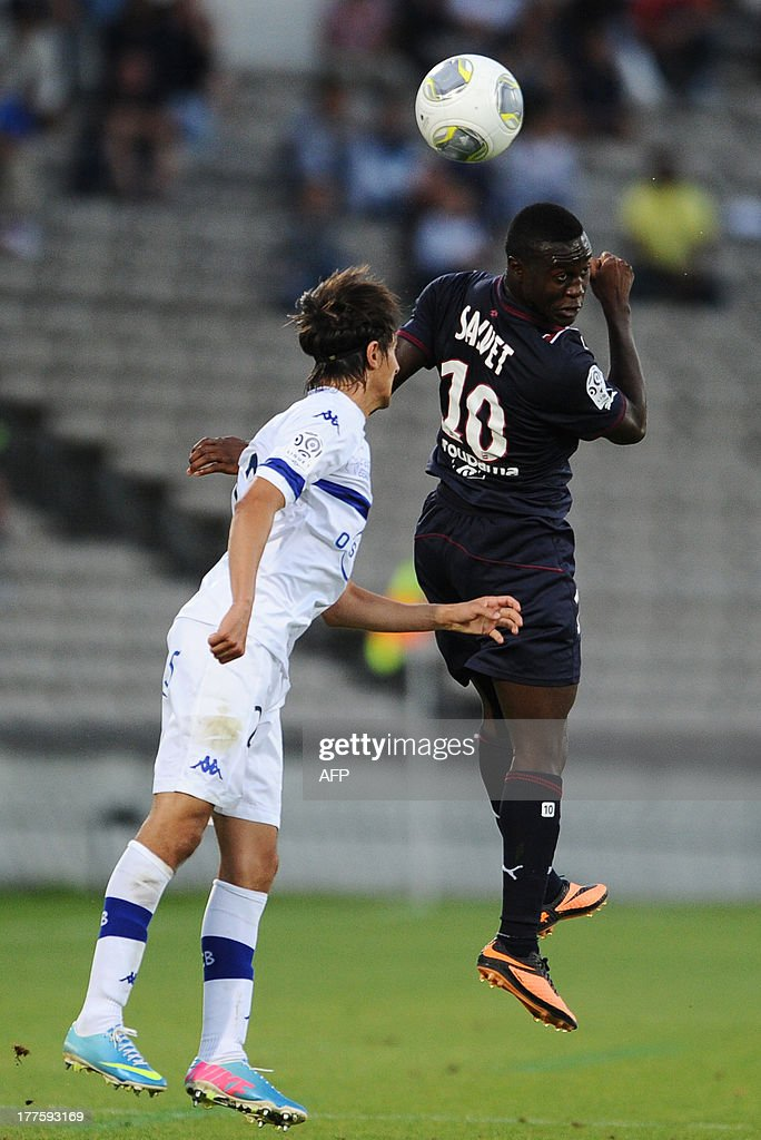 Bordeaux forward Henri Saivet vies with Bastia's defender Fethi Harek during the French L1 football match between Bordeaux and Bastia on August 24 at...