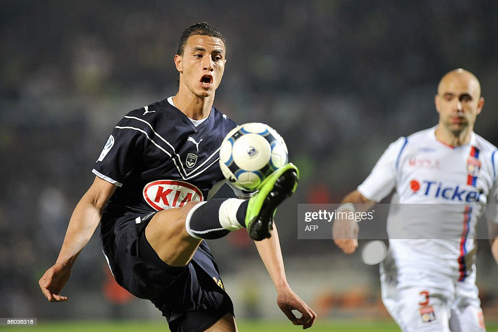 Bordeaux' forward Marouane Chamakh vies with Lyon's defender Cris during their French L1 football match Bordeaux vs Lyon at Chaban Delmas Stadium in...