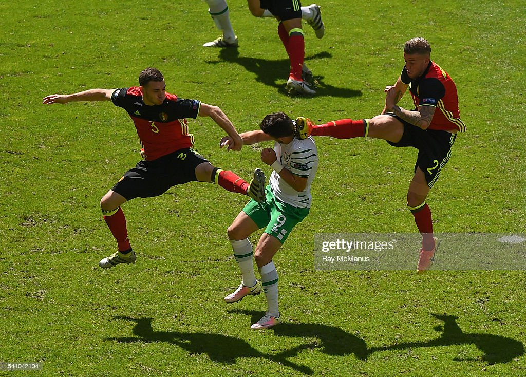 Bordeaux , France - 18 June 2016; <a gi-track='captionPersonalityLinkClicked' href=/galleries/search?phrase=Shane+Long&family=editorial&specificpeople=661194 ng-click='$event.stopPropagation()'>Shane Long</a> of Republic of Ireland in action against <a gi-track='captionPersonalityLinkClicked' href=/galleries/search?phrase=Thomas+Vermaelen&family=editorial&specificpeople=1360240 ng-click='$event.stopPropagation()'>Thomas Vermaelen</a>, left, and <a gi-track='captionPersonalityLinkClicked' href=/galleries/search?phrase=Toby+Alderweireld&family=editorial&specificpeople=653048 ng-click='$event.stopPropagation()'>Toby Alderweireld</a> of Belgium during the UEFA Euro 2016 Group E match between Belgium and Republic of Ireland at Nouveau Stade de Bordeaux in Bordeaux, France.
