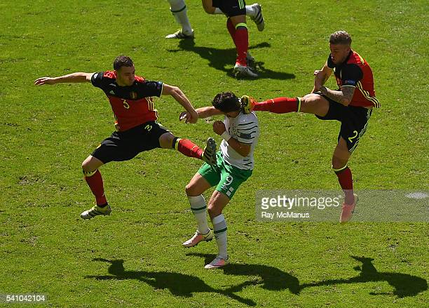 Bordeaux France 18 June 2016 Shane Long of Republic of Ireland in action against Thomas Vermaelen left and Toby Alderweireld of Belgium during the...