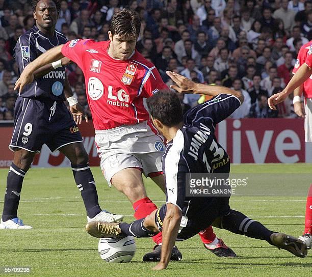 Bordeaux's defender David Jemmali tackles Lyon's Brazilian midfielder Juninho during their French L1 football match 17 September 2005 at the Chaban...