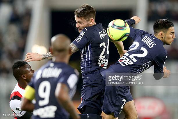 Bordeaux' French Defender Mathieu Debuchy and Bordeaux' French midfielder Adam Ounas jump for the ball during the French Ligue 1 football match...
