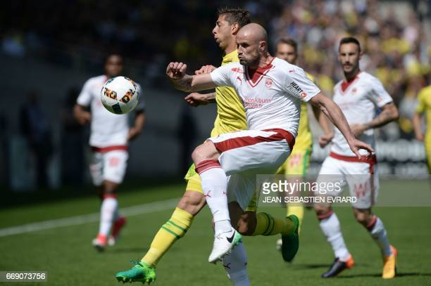 Bordeaux' French defender Nicolas Pallois vies with Nantes' Argentinian forward Emiliano Sala during the French L1 football match between Nantes and...