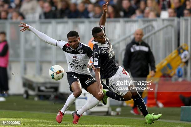 Bordeaux' French forward Francois Kamano vies with Guingamp's French midfielder Marcus Coco during the French L1 football match between Bordeaux and...
