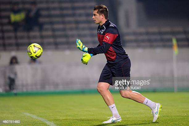 Bordeaux' French goalkeeper Cedric Carrasso warms up before the French L1 football match between Girondins de Bordeaux and Lyon on December 21 2014...