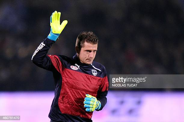 Bordeaux' French goalkeeper Cedric Carrasso waves before the French L1 football match between Girondins de Bordeaux and Lyon on December 21 2014 at...