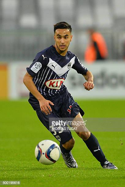 Bordeaux' French midfielder Adam Ounas runs with the ball during the French Ligue1 football match between Bordeaux and Guingamp on December 6 2015 at...