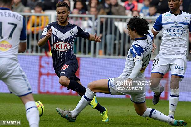 Bordeaux' French midfielder Adam Ounas vies with Bastia's French defender FrancoisJoseph Modesto during the French Ligue 1 football match between...