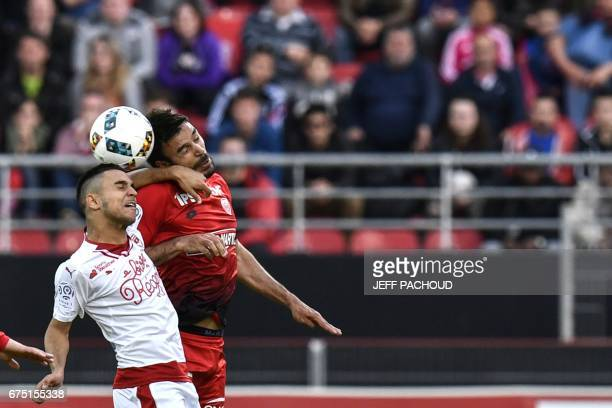 Bordeaux' French midfielder Adam Ounas vies with Dijon's French defender Quentin Bernard during the French L1 football match Dijon vs Bordeaux on...