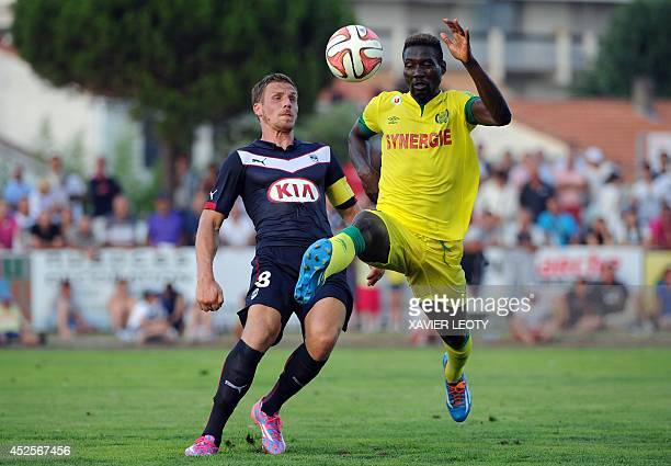 Bordeaux' French midfielder Gregory Sertic fights for the ball with Nantes' Guinean forward Ismael Bangoura during the French football match between...