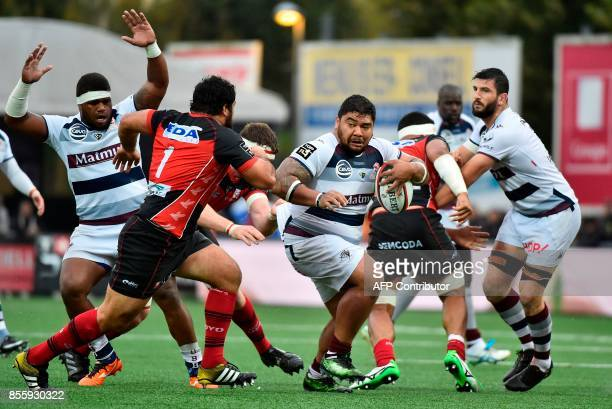 Bordeaux' French prop Romain Taofifenua runs with the ball during the French Top 14 rugby union match between Oyonnax and BordeauxBegles on September...