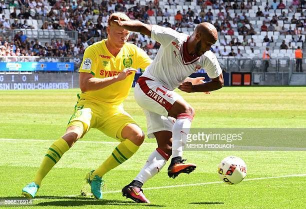 Bordeaux' Ivorian forward Thomas Touré vies with Nantes' Icelandic forward Kolbeinn Sigthorsson during the French L1 football match Bordeaux vs...