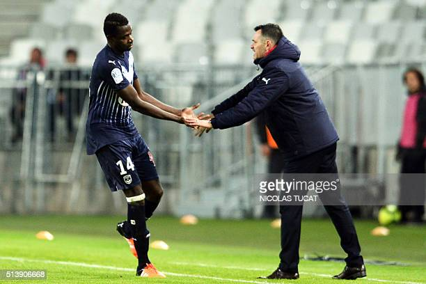 Bordeaux' Malian forward Cheick Diabate celebrates with his coach Willy Sagnol after scoring during the French L1 football match between Bordeaux and...