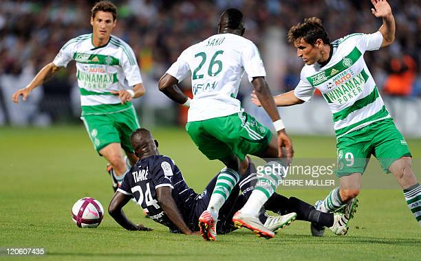 Bordeaux Malian midfielder Abdou Traore fights for the ball with SaintEtienne's midfielder Bakary Sako and Argentinian Ruben Bergessio during the...