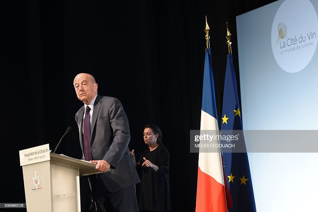 Bordeaux Mayor Alain Juppe delivers a speech during the inauguration of the Cite du Vin (Wine Museum) on May 31, 2016 in Bordeaux, western France. New cultural, touristic and architectural symbol of Bordeaux, the Wine Museum, would like to attract 450,000 visitors per year. It will open on June 1. / AFP / POOL / MEHDI