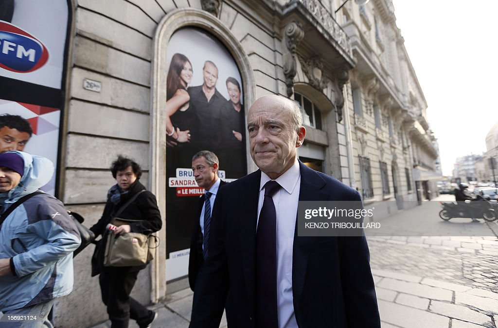 Bordeaux mayor and founder of the French opposition right-wing UMP party, Alain Juppe, arrives on November 25, 2012, at the headquarters of French radio station Europe 1 in Paris to participate in the 'Le Grand Rendez-Vous' program. Party heavyweight Juppe, a former premier and foreign minister, will hold a mediation meeting later in the day with the right-winger, who was declared the winner of November 22 knife-edge vote to pick a party leader, Jean-Francois Cope, and his centrist rival Francois Fillon. The talks are to establish who actually won the leadership and whether mutual allegations of ballot rigging have any foundation. AFP PHOTO / KENZO TRIBOUILLARD