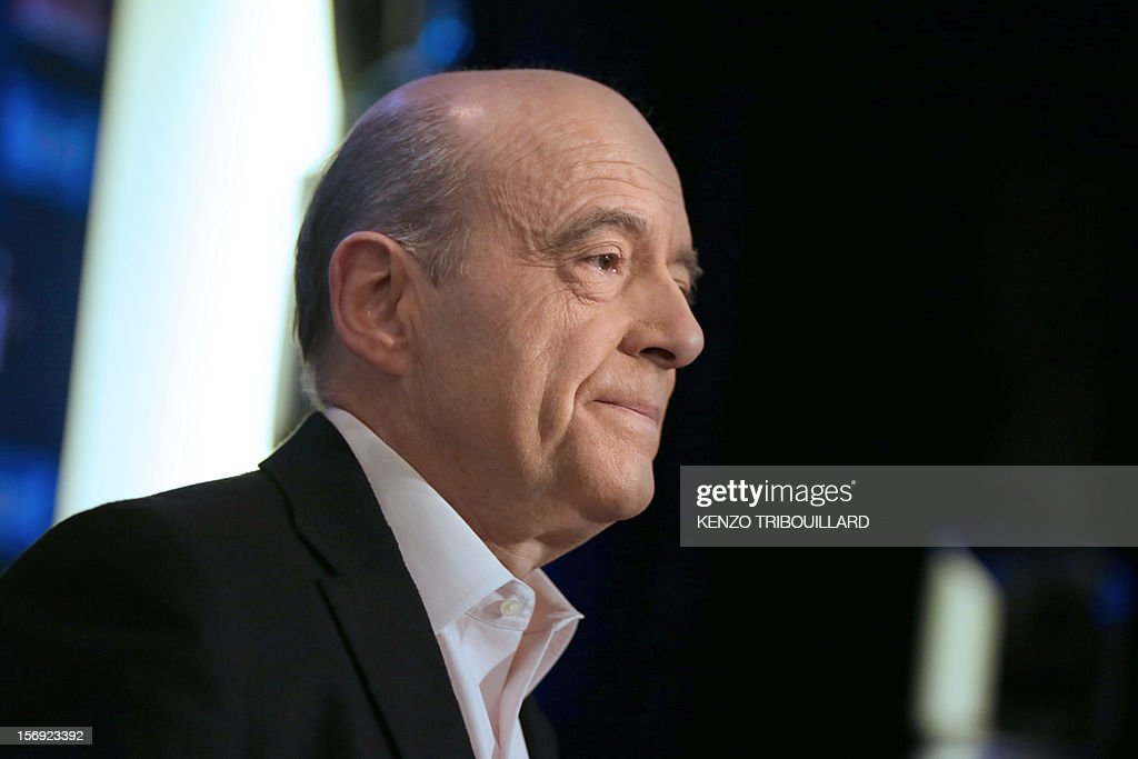Bordeaux mayor and founder of the French opposition right-wing UMP party, Alain Juppe answers journalists' questions as he participates in the 'Le Grand Rendez-Vous' program at the headquarters of French radio station Europe 1 in Paris, on November 25, 2012. Party heavyweight Juppe, a former premier and foreign minister, will hold a mediation meeting later in the day with the right-winger, who was declared the winner of November 22 knife-edge vote to pick a party leader, Jean-Francois Cope, and his centrist rival Francois Fillon. The talks are to establish who actually won the leadership and whether mutual allegations of ballot rigging have any foundation. AFP PHOTO / KENZO TRIBOUILLARD