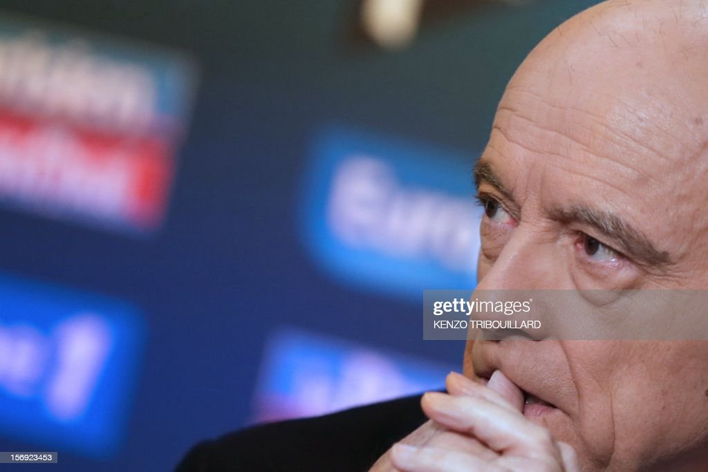 Bordeaux mayor and founder of the French opposition right-wing UMP party, Alain Juppe looks on as he participates in the 'Le Grand Rendez-Vous' program at the headquarters of French radio station Europe 1 in Paris, on November 25, 2012. Party heavyweight Juppe, a former premier and foreign minister, will hold a mediation meeting later in the day with the right-winger, who was declared the winner of November 22 knife-edge vote to pick a party leader, Jean-Francois Cope, and his centrist rival Francois Fillon. The talks are to establish who actually won the leadership and whether mutual allegations of ballot rigging have any foundation.